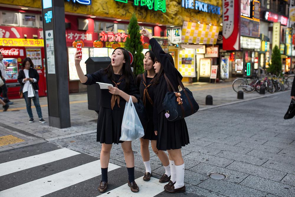 TOKYO, JAPAN - OCTOBER 20 : A high school students taking selfie in Kabukicho, Shinjuku district Tokyo, Japan on October 20, 2015. <br /> <br /> Photo: Richard Atrero de Guzman