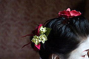 Miki Suzuki dresses in a Geisha costume in preparation for a performance at the annual Arts Festival in Edinburgh, Scotland. The Festival features hundreds of international theater and music performances and attracts street performers from all over the world..
