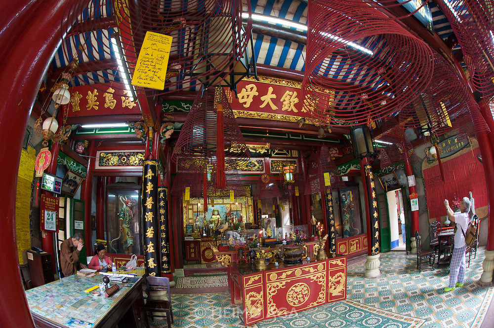 Hokien (Fujian) Meeting Hall (Phuc Kien), 46 Tran Phu Street. Built in 1757. Incense and other donations.?   It is said that Phuc Kien Assembly hall was once a small temple where Thien Hau Thanh Mau statue (a goddess who protects merchants sailing in the sea) was worshiped. It was picked up on the beach of Hoi An in 1697. Due to restorations and support of the Fukien people, the Assembly hall became resplendent and spacious taking part in the embellishment of Hoi An architecture.