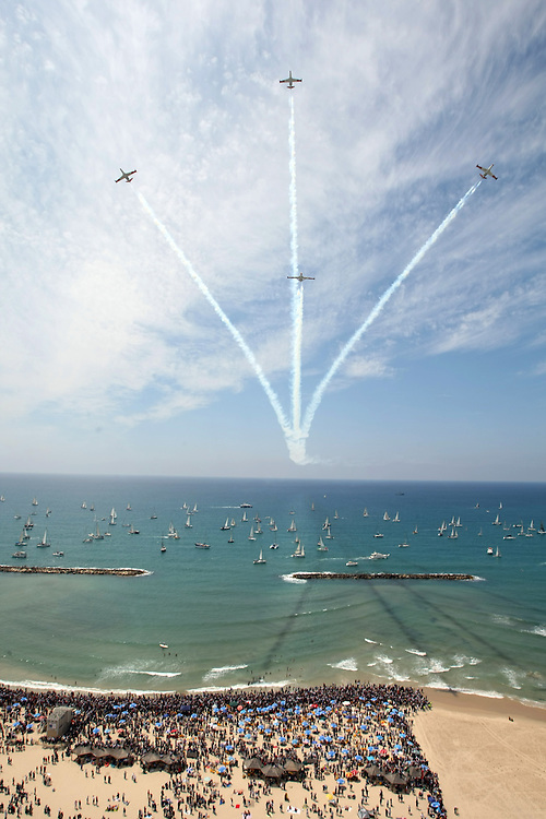 Jets fly over the coastline during an aerial show marking Israel's 60th anniversary in Tel Aviv, Thursday, May 7, 2008. Israel is marking its 60th Independence Day