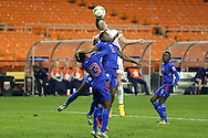 20 October 2014: Abby Wambach (USA) (behind) heads the ball over Shanna Hudson (HAI) (15) and Marie Jean Pierre (HAI) (13). The United States Women's National Team played the Haiti Women's National Team at RFK Memorial Stadium in Washington, DC in a 2014 CONCACAF Women's Championship Group A game, which serves as a qualifying tournament for the 2015 FIFA Women's World Cup in Canada. The U.S. won the game 6-0.