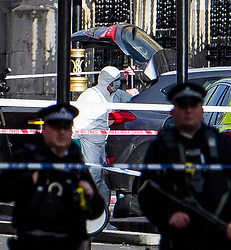 © Licensed to London News Pictures. 22/03/2017. London, UK. Police forensics examine a car (grey) involved in the incident, at the scene of suspected terrorist attack near Houses of Parliament in Westminster, London. Photo credit: Ben Cawthra/LNP