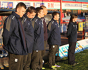 The Dundee bench observe the minutes silence for former Dark Blue Ian Redford - Dundee v Livingston,  SPFL Championship at Dens Park<br /> <br />  - &copy; David Young - www.davidyoungphoto.co.uk - email: davidyoungphoto@gmail.com