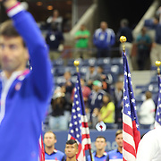 Novak Djokovic, Serbia, with the trophy after winning the Men's Singles Final with Roger Federer, Switzerland, in the background during the US Open Tennis Tournament, Flushing, New York, USA. 13th September 2015. Photo Tim Clayton