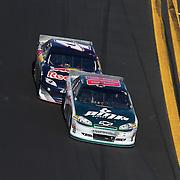 Sprint Cup Series driver Dale Earnhardt Jr. (88) leads Sprint Cup Series driver Kasey Kahne (4) during the Daytona 500 at Daytona International Speedway on February 20, 2011 in Daytona Beach, Florida. (AP Photo/Alex Menendez)