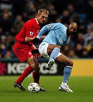 Photo: Richard Lane.<br /> Manchester City v Liverpool. Barclaycard Premiership.<br /> 28/12/2003.<br /> Nicolas Anelka holds the ball away from Sami Hypia.