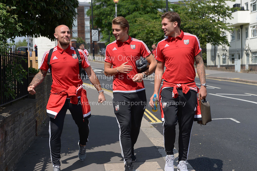 Alan McCormack of Brentford (l) James Tarkowski of Brentford (c) and Alan Judge of Brentford (r) arrive at Griffin Park before k/o. Skybet football league Championship match, Brentford v Ipswich Town at Griffin Park in London on Saturday 8th August 2015.<br /> pic by John Patrick Fletcher, Andrew Orchard sports photography.