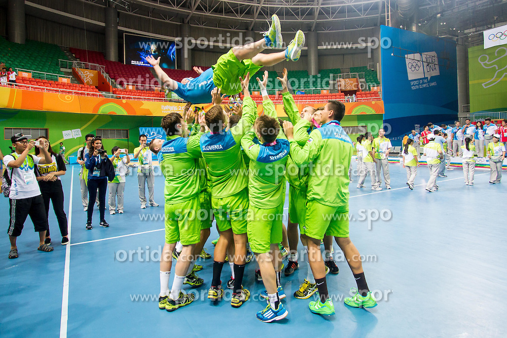 Slovenian handball team after winning gold medal at 2nd Youth Olympic Games in Nanjing, China. Foto by: Peter Kastelic/Sportida