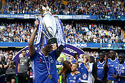 Chelsea Defender John Terry (26) celebrates with the trophy during the Premier League match between Chelsea and Sunderland at Stamford Bridge, London, England on 21 May 2017. Photo by Andy Walter.