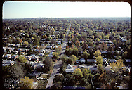 Aerial view of St. Louis suburb with high-rises of Clayton business district on horizon. Missouri