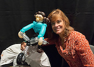 Garden City, New York, U.S. - June 14, 2014 - Actress CATHERINE MARIE STEWART (Weekend at Bernie's) poses with a balloon girl riding a motorcycle at Eternal Con, the annual Pop Culture Expo, with costumes, Comic Books, Collectibles, Gaming, Sci-Fi, Cosplay, Horror, and held at the Cradle of Aviation Museum on Long Island. Stewart rides a motorcycle in the zombie movie Night of the Comet)