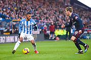Elias Kachunga of Huddersfield Town (9) takes on Nacho Monreal of Arsenal (18) during the Premier League match between Huddersfield Town and Arsenal at the John Smiths Stadium, Huddersfield, England on 9 February 2019.