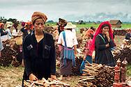 Minority women selling goods at market at Inle region