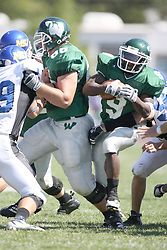 15 September 2007:  Marcus Dunlop sneaks through the line receiving a key block complements of Eric Van Hise. The Titans stood toe to toe with the 25th ranked Lions through the first half but ended the game on the losing end of a 25-15 score at Wilder Field on the campus of Illinois Wesleyan University in Bloomington Illinois.