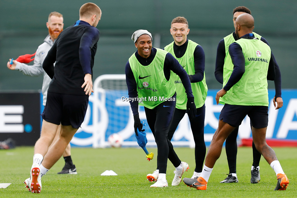SAINT PETERSBURG, RUSSIA - JULY 10: Ashley Young (C) of England national team plays with toy rooster during an Englang national team training session ahead of the 2018 FIFA World Cup Russia Semi Final match against Croatia at Stadium Spartak Zelenogorsk on July 10, 2018 in Saint Petersburg, Russia. (MB Media)