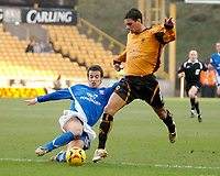 Photo: Ed Godden.<br />Wolverhampton Wanderers v Ipswich Town. Coca Cola Championship. 18/02/2006. <br />Sito Castro (L) brings down Wolves' Jeremie Aliadiere for a penalty.