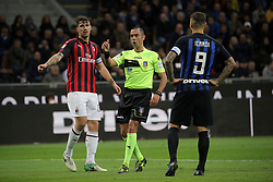 October 21, 2018 - Milan, Milan, Italy - Referee Marco Guida speaks with Mauro Icardi #9 of FC Internazionale Milano and Alessio Romagnoli #13 of AC Milan during the serie A match between FC Internazionale and AC Milan at Stadio Giuseppe Meazza on October 21, 2018 in Milan, Italy. (Credit Image: © Giuseppe Cottini/NurPhoto via ZUMA Press)