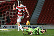 Jak Alnwick (Port Vale) makes a save from Andy Williams (Doncaster Rovers) during the Sky Bet League 1 match between Doncaster Rovers and Port Vale at the Keepmoat Stadium, Doncaster, England on 26 January 2016. Photo by Mark P Doherty.