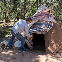 Dr. Eduardo Valda shows the traditional sweat lodge available to guests of the Hózhó Sheep Camp bed and breakfast in Sheep Springs on September 21, 2019 after the blessing ceremony of the hogan.
