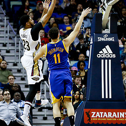 Dec 13, 2016; New Orleans, LA, USA;  New Orleans Pelicans forward Anthony Davis (23) shoots over Golden State Warriors guard Klay Thompson (11) during the second quarter of a game at the Smoothie King Center. Mandatory Credit: Derick E. Hingle-USA TODAY Sports