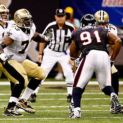 August 21, 2010; New Orleans, LA, USA; New Orleans Saints guard Jahri Evans (73) pass blocks during the first quarter of a preseason game against the Houston Texans at the Louisiana Superdome. Mandatory Credit: Derick E. Hingle