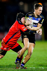 Bath United Winger Liam Forsyth is tackled by Bristol United Prop Kyle Traynor - Mandatory byline: Rogan Thomson/JMP - 28/12/2015 - RUGBY UNION - The Recreation Ground - Bath, England - Bath United v Bristol United - Aviva A League.