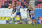 Sam Hart heads clear Michael Jacobs during the EFL Sky Bet League 1 match between Wigan Athletic and Rochdale at the DW Stadium, Wigan, England on 24 February 2018. Picture by Daniel Youngs.