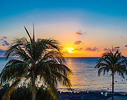 Sunset in Cozumel is spectacular in color and beauty as it slowly sinks into the ocean.