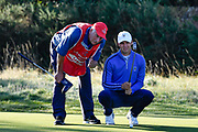 Alex Smalley (USA) and caddy Bryn Jones (USA) line up a putt on the second hole during the Sunday Foursomes in the Walker Cup at the Royal Liverpool Golf Club, Sunday, Sept 8, 2019, in Hoylake, United Kingdom. (Steve Flynn/Image of Sport)