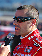 Dario Franchitti talks to reporter in Memphis at the NASCAR race Memphis Motorsports Park.