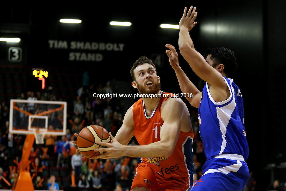 Nick Kay (L) of the Sharks drives pass Damian Ekenasio of the Saints in the NBL basketball match between the Southland Sharks and Wellington Saints, ILT Stadium Southland, Invercargill, Sunday, May 22, 2016. Photo: Dianne Manson / www.photosport.nz