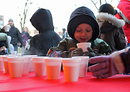 Grant Crosen, 4, of Marion, picks up a cup of hot cocoa during Christmas in the Park and Peppermint Walk at City Square Park in Marion on Friday evening, December 2, 2011. (Stephen Mally/Freelance)