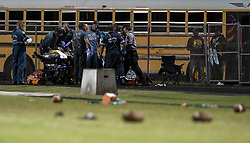 August 18, 2018 - Wellington, Florida, U.S. - A shooting victim is worked on before being taken by Trauma Hawk to a hospital. Two adults were shot Friday night at a football game between Palm Beach Central and William T. Dwyer high schools, authorities said. The gunfire sent players and fans screaming and stampeding in panic during the fourth quarter of the game at Palm Beach Central High School in Wellington, Florida on August 17, 2018. (Credit Image: © Allen Eyestone/The Palm Beach Post via ZUMA Wire)