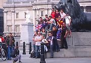 AWFP81 Tourist group pose for camera Trafalgar Square London England
