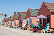 Beachfront Pink Cottage Rentals on the North Strand by the Oceanside Pier