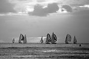 Sailing race at sunset off Waikiki Beach in Honolulu, Hawaii