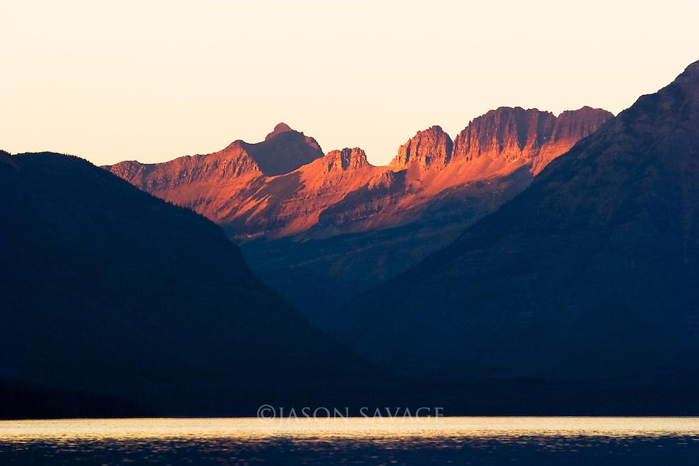Mountains loom over Lake McDonald in Glacier National Park, Montana.