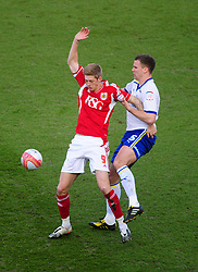 Bristol City's Jon Stead battles for the ball with Cardiff City's Mark Hudson - Joe Meredith/JMP - 10/03/12 - SPORT - FOOTBALL -  Championship -  Ashton Gate - Bristol, England - Bristol City v Cardiff City