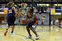 19 March 2010: Philana Greene pulls up for a three pointer working off a screen by Carrie Snikkers. The Flying Dutch of Hope College defeat the Yellowjackets of the University of Rochester in the semi-final round of the Division 3 Women's Basketball Championship by a score of 86-75 at the Shirk Center at Illinois Wesleyan in Bloomington Illinois.