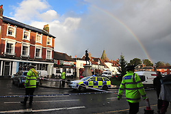 © Licensed to London News Pictures. 24/12/2015<br /> As a private ambulance takes the body away a rainbow appears in the sky above Westerham.<br /> Costa Coffee car crash Westerham in Kent. Six people taken to hospital.<br /> (Byline:Grant Falvey/LNP)