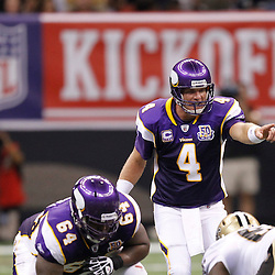 September 9, 2010; New Orleans, LA, USA; Minnesota Vikings quarterback Brett Favre (4) calls a play at the line of scrimmage against the New Orleans Saints during first half of the NFL Kickoff season opener at the Louisiana Superdome. Mandatory Credit: Derick E. Hingle