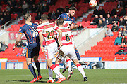 Blackpool defender Clark Robertson (5)  with a header during the Sky Bet League 1 match between Doncaster Rovers and Blackpool at the Keepmoat Stadium, Doncaster, England on 28 March 2016. Photo by Simon Davies.