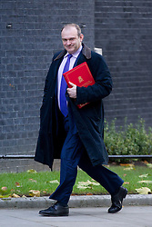 © Licensed to London News Pictures. 26/11/2013. London, UK. The Energy and Climate Secretary, Ed Davey, leaves Number 10 Downing Street after a meeting of British Prime Minister David Cameron's Cabinet on Downing Street in London today (26/11/2013). Photo credit: Matt Cetti-Roberts/LNP