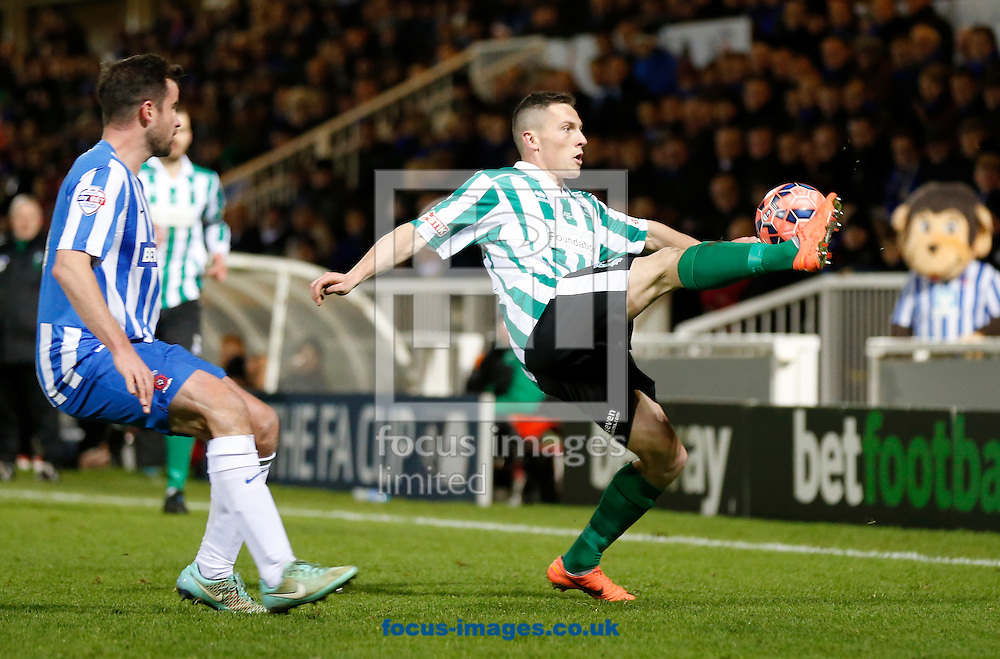 Matthew Bates of Hartlepool United and Daniel Maguire of Blyth Spartans during the The FA Cup match at Victoria Park, Hartlepool<br /> Picture by Simon Moore/Focus Images Ltd 07807 671782<br /> 05/12/2014