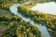 Aerial. Boise, Idaho and Boise River detail with green trees.
