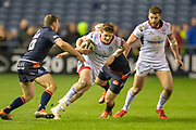 Angus Kernohan (#23) of Ulster Rugby looks to break the tackles of Matt Scott (#12) and Mark Bennett (#13) of Edinburgh Rugby during the Guinness Pro 14 2018_19 match between Edinburgh Rugby and Ulster Rugby at the BT Murrayfield Stadium, Edinburgh, Scotland on 12 April 2019.
