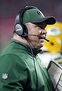 Green Bay Packers head coach Mike McCarthy talks on his headsets on the sideline during the NFL NFC Divisional round playoff football game against the Arizona Cardinals on Saturday, Jan. 16, 2016 in Glendale, Ariz. The Cardinals won the game in overtime 26-20. (©Paul Anthony Spinelli)