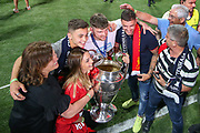 CHAMPIONS Liverpool defender Alberto Moreno (18) takes photos with family and friends, and the Champions League Trophy, after Liverpool win the UEFA Champions League Final match between Tottenham Hotspur and Liverpool at Wanda Metropolitano Stadium, Madrid, Spain on 1 June 2019.