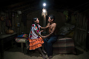 Faustina Flores Carranza (66) and her husband Juan Astudillo Jesus (63) sit in their solar-lit home in San Luis Acatlan, Guerrero, Mexico. Faustina and Juan have seven children and are together since 48 years. Like many members of the Mextica Indigenous Community, they have never had access to electricity. <br /> <br /> When asked how having solar has impacted their lives, Faustina said, ''For the first time, we are able to look at each in the eyes in our moments of intimacy.''