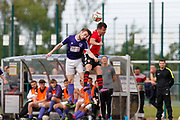 City of Liverpool's Michael Roberts (purple)  and   Litherland's Michael Boyle (Red) during the North West Counties League Play Off Final match between Litherland REMYCA and City of Liverpool FC at Litherland Sports Park, Litherland, United Kingdom on 13 May 2017. Photo by Craig Galloway.